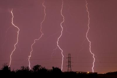Multiple Lightning Strikes During an Intense Lightning Storm Pounds Dallas by Mike Theiss