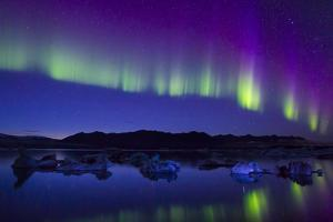 Northern Lights During a Geomagnetic Solar Storm So Intense That They Reflected Off Freezing Water by Mike Theiss