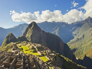 Sun Shining Through the Andes Mountains onto Machu Picchu at Sunset by Mike Theiss