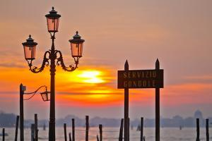Sunrise over the Gondola Station at Saint Mark's Square in Venice by Mike Theiss