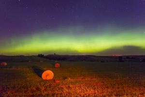 The Aurora Borealis or Northern Lights over Agricultural Land by Mike Theiss