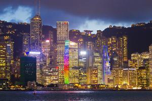 The Hong Kong Skyline Along Victoria Harbor Lit Up at Night by Mike Theiss