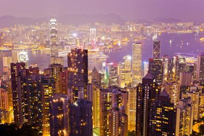 The Hong Kong Skyline and Victoria Harbor Lit Up at Sunset, as Seen from Victoria Peak by Mike Theiss