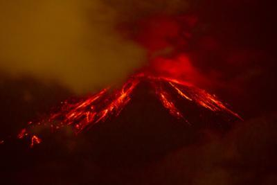 The Tungurahua Volcano Erupting at Night by Mike Theiss