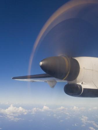 View of a Spinning Propeller from Window of a Prop Engine Airplane by Mike Theiss