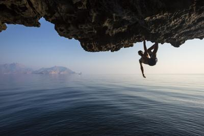 A Climber Dangles from an Overhang