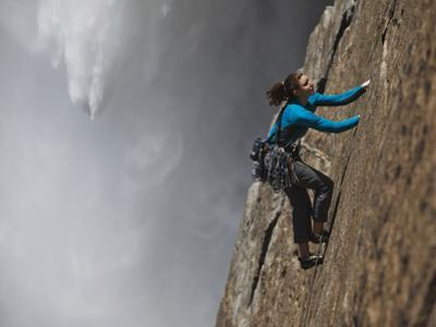 A Climber, Without a Rope, Jams Her Hands into Fissures for Ascent