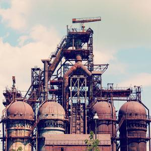 Building a Blast Furnace at the Steel Industry on a Background of Blue Sky by Mikhail St
