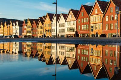 Famous Bryggen Street with Wooden Colored Houses in Bergen, Norway, UNESCO World Heritage Cite - Ar by Mikhail Varentsov