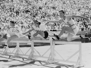 Mildred 'Babe' Didrikson, Running the 80-Meter Hurdles, at the 1932 Olympics