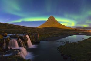 Aurora (Northern Lights) over a moonlit Kirkjufell Mountain, Snaefellsnes Peninsula, Iceland, Polar by Miles Ertman