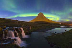 Aurora (Northern Lights) over a moonlit Kirkjufell Mountain, Snaefellsnes Peninsula, Iceland, Polar by Miles Ertman