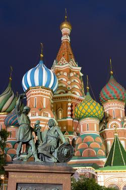 St. Basil's Cathedral and the statue of Kuzma Minin and Dmitry Posharsky lit up at night, UNESCO Wo by Miles Ertman