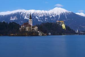 The Assumption of Mary Pilgrimage Church on Lake Bled and Bled Castle at Dusk, Bled, Slovenia by Miles Ertman