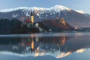 The Assumption of Mary Pilgrimage Church on Lake Bled and Bled Castle, Bled, Slovenia, Europe by Miles Ertman