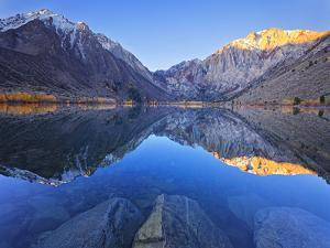 Dawn at Convict Lake in the Fall before the Fisherman Get on the Lake in California. by Miles Morgan