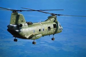 Military Helicopter Flying in Blue Skies