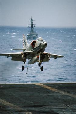 Military Plane Landing on Flight Deck