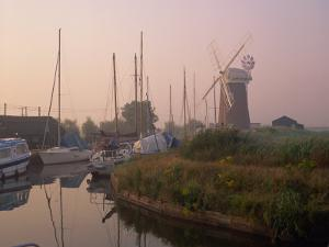 Horsey Wind Pump and Boats Moored on the Norfolk Broads at Dawn, Norfolk, England, United Kingdom by Miller John