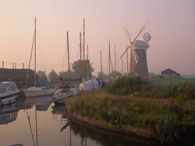 Horsey Wind Pump and Boats Moored on the Norfolk Broads at Dawn, Norfolk, England, United Kingdom