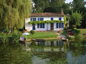 House with Pond in Garden, Coulon, Marais Poitevin, Poitou Charentes, France, Europe by Miller John