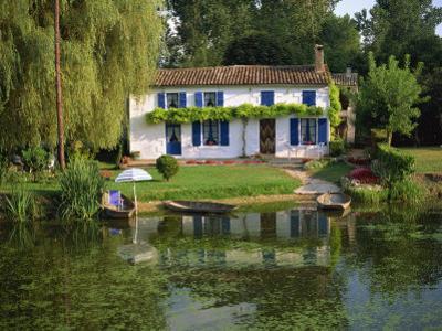 House with Pond in Garden, Coulon, Marais Poitevin, Poitou Charentes, France, Europe