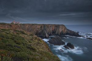 Cabo Sardao Lighthouse is a Historic Light on the Cliffs along the Coast of the Cabo Sardao in Port by Mint Images - David Schultz