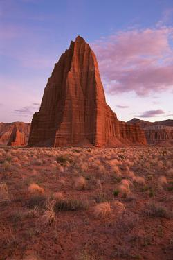 Temple of the Sun and Temple of the Moon, in the National Park at Capitol Reef in Utah. by Mint Images - David Schultz