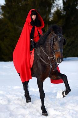 Beautiful Woman with Red Cloak with Horse Outdoor in Winter by mirceab