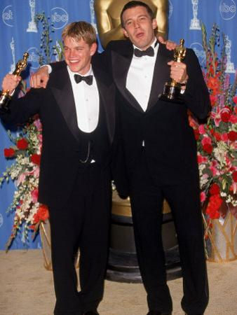 Actors Screenwriters Matt Damon and Ben Affleck Holding their Oscars in Press Room Atacademy Awards by Mirek Towski