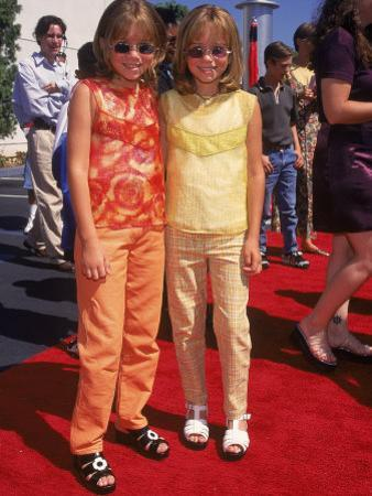 "Twin Actresses Mary Kate and Ashley Olsen at the Film Premiere of ""Honey I Shrunk the Kids"" by Mirek Towski"