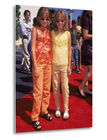 """Twin Actresses Mary Kate and Ashley Olsen at the Film Premiere of """"Honey I Shrunk the Kids"""" by Mirek Towski"""