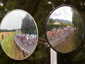 Mirrors at a T-Junction Reflect Riders During the 18th Stage of the Tour De France