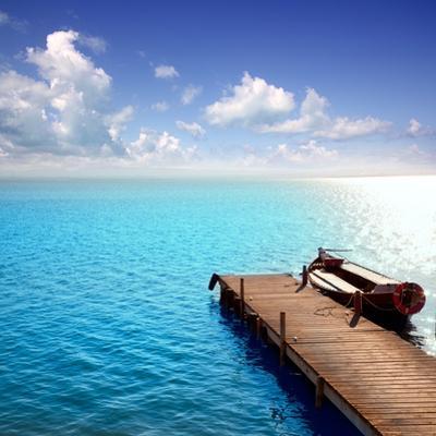 Albufera Blue Boats Lake in El Saler Valencia Spain by Miscellaneoustock