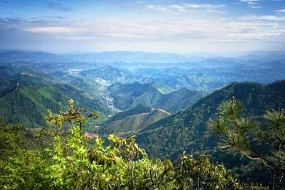 https://imgc.allpostersimages.com/img/posters/misty-mountain-chains-and-valley-with-village-as-seen-from-tian-mu-shan-peak-zhejiang-china_u-L-PWFCYU0.jpg?p=0