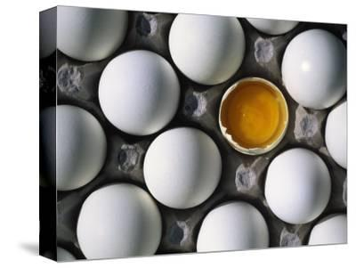 Cracked Egg in the Middle of Other Eggs by Mitch Diamond