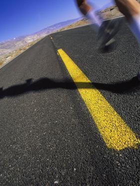 Jogger on Desert Road by Mitch Diamond