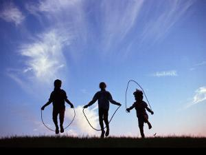 Silhouette of Children Playing Outdoors by Mitch Diamond