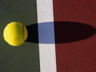Tennis Ball on Court by Mitch Diamond