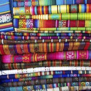 Colorful Blankets at Indigenous Market in Pisac, Peru by Miva Stock