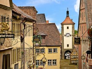 Cross Timbered Houses and Clock Tower, Rothenburg Ob Der Tauber, Germany by Miva Stock