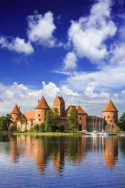 Lithuania, Vilnius. Trakai Castle reflected Galve lake in Lithuania by Miva Stock