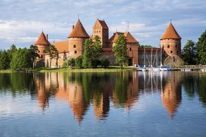 Lithuania, Vilnius. Trakai Castle reflected Galve lake in Lithuania. by Miva Stock