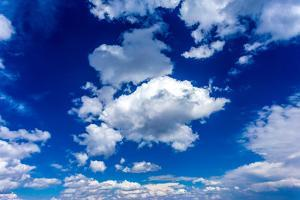 Blue Sky and Clouds by mmphoto