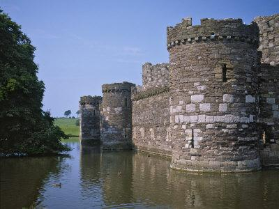 https://imgc.allpostersimages.com/img/posters/moat-and-outer-curtain-wall-at-beaumaris-castle_u-L-P91M4V0.jpg?p=0