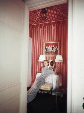 Model Barbara Mullen Photographed at the Apartment of Mrs. Thompson Biddle Wearing a Beige Dress