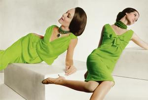 Model in Green Malcolm Starr Dress with Shoulder Sashes and Model in Green Oleg Cassini Dress