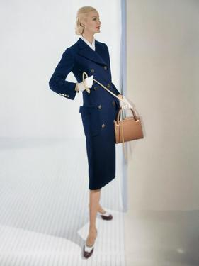 Model Sunny Harnett Wearing Long-Bodied, Slim Lined Navy Blue Wool Coat with Brass Buttons