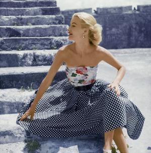 Model Sunny Harnett Wearing Strapless Floral Top with Black-White Checked Full Skirt