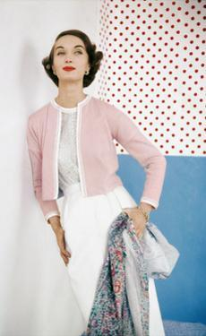Model Wearing Pink Sweater over Confetti-Print Cotton Blouse by Evelyn Gates